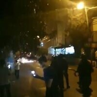 Ultra-Orthodox rioters clash with cops in Jerusalem's Mea Shearim neighborhood, April 19, 2021. (Screenshot: Twitter)