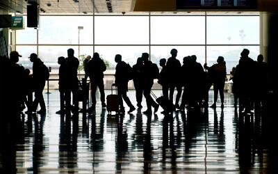 Travelers walk through the Salt Lake City International Airport in Salt Lake City, Utah, March 17, 2021. (AP Photo/Rick Bowmer, file)