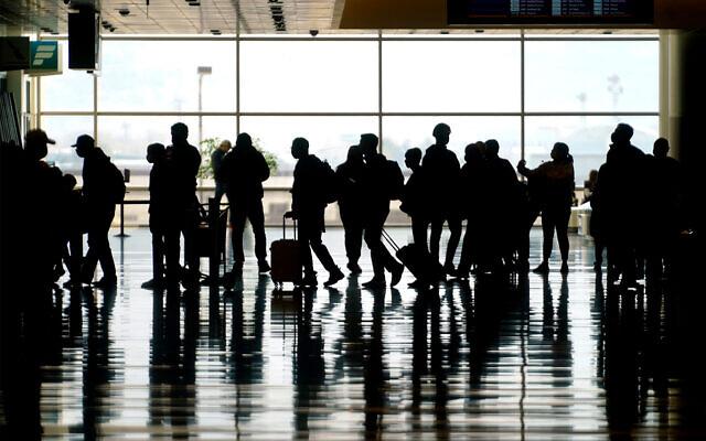Travelers walk through the Salt Lake City International Airport in Salt Lake City, Utah, March 17, 2021. (AP Photo/Rick Bowmer, file)