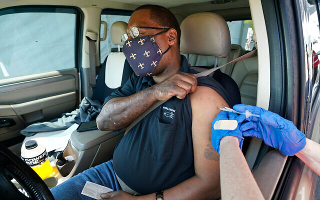 A man receives a drive-thru vaccination in Metairie, Louisiana, just outside New Orleans, March 29, 2021. (AP Photo/Gerald Herbert)
