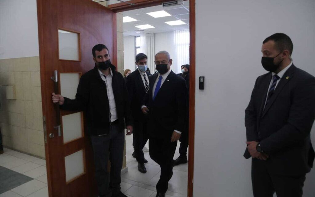 Prime Minister Benjamin Netanyahu, center, leaving a courtroom at the Jerusalem District Court during a hearing in his corruption trial, April 5, 2021. (Oren Ben Hakoon/Pool)