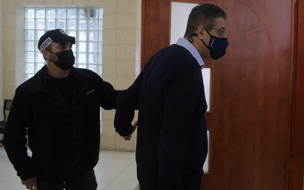Former Walla editor Ilan Yeshua enters a courtroom at the Jerusalem District Court for a hearing in Prime Minister Benjamin Netanyahu's corruption trial, April 5, 2021. (Oren Ben Hakoon/Pool)