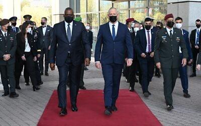 Defense Minister Benny Gantz, right, walks alongside US Defense Secretary Lloyd Austin during an honor guard ceremony at Israel's military headquarters in Tel Aviv on April 11, 2021. (Ariel Hermoni)