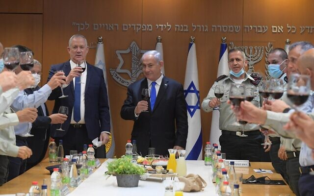 (L-R) Defense Minister Benny Gantz, Prime Minister Benjamin Netanyahu and IDF chief-of-staff Aviv Kohavi at an Indendence Day toast with security chiefs at the Kirya military headquarters in Tel Aviv on April 11, 2021. (Amos Ben Gershom/GPO)
