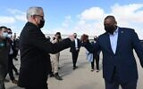 Defense Minister Benny Gantz, left, fist-bumps US Defense Secretary Lloyd Austin at the Nevatim Air Base in southern Israel on April 12, 2021. (Ariel Hermoni/Defense Ministry)