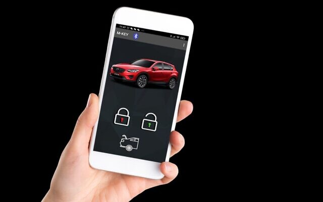 Cobra, an Israeli maker of automotive safety devices and door-locking systems, launches its Mobile-Key technology to open cars via an app, no need for keys (Courtesy)