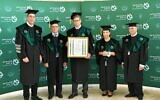 Tal Zaks (C), Moderna's chief medical officer, receives an honorary doctorate during a ceremony at Bar-Ilan University on April 26, 2021. (Courtesy)