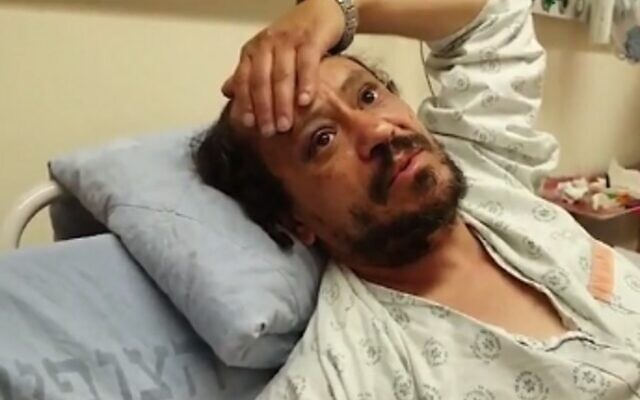 Yahya Jardi speaks from his hospital bed at Hadassah Medical Center in Jerusalem after being beaten by multiple assailants during violent clashes in Jerusalem, on April 23, 2021 (video screenshot)