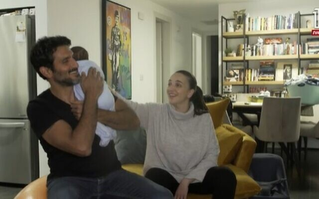 Lucy Aharish, Tsahi Halevy and their baby (screen capture: Channel 12)