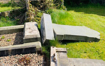 The aftermath of vandalism at the Jewish section of a municipal cemetery in Belfast, Northern Ireland, April 16, 2021. (Courtesy of Steven Corr, via JTA)