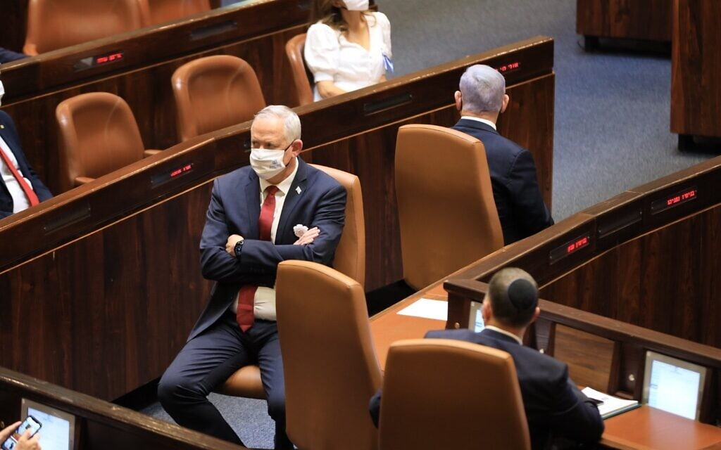 Defense Minister Benny Gantz (left) and Prime Minister Benjamin Netanyahu at the swearing-in ceremony for the 24th Knesset, April 6, 2021. (Knesset spokesperson)