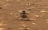 In this image from NASA, NASA's experimental Mars helicopter Ingenuity stands on the surface of Mars (NASA via AP)