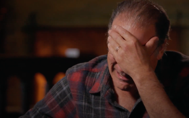 """Mandy Patinkin cries during his episode of """"Finding Your Roots."""" (Screen capture: YouTube)"""