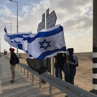 Israelis protest against Prime Minister Benjamin Netanyahu at a junction near Tlalim, southern Israel, on April 10, 2021 (Courtesy: The Black Flags)