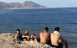 Israeli tourists at Ras Sheitan in the Sinai Peninsula, Egypt, on April 5, 2021. (Jacob Magid/Times of Israel)