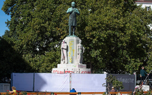 A fence in Vienna surrounds the statue of Karl Lueger, the antisemitic former mayor of the Austrian capital, October 6, 2020. (Joe Klamar/AFP via Getty Images)