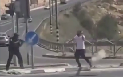 In this image from video, a suspect attempts to stab a police officer with a sharp object near the West Bank city of Efrat on April 30, 2021 (Screenshot: Twitter)