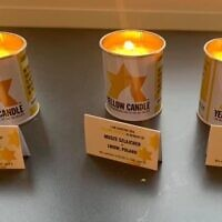Debra Barnes's friend Karen posted a photo of the yellow candles online -- without knowing one of them (left) was in memory of Debra's aunt. (Courtesy Jewish News)