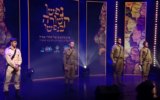 Presenters at a memorial event for ultra-Orthodox soldiers in Jerusalem on April 13, 2021. (screen capture: YouTube/ Bogrei Netzah Yehuda)