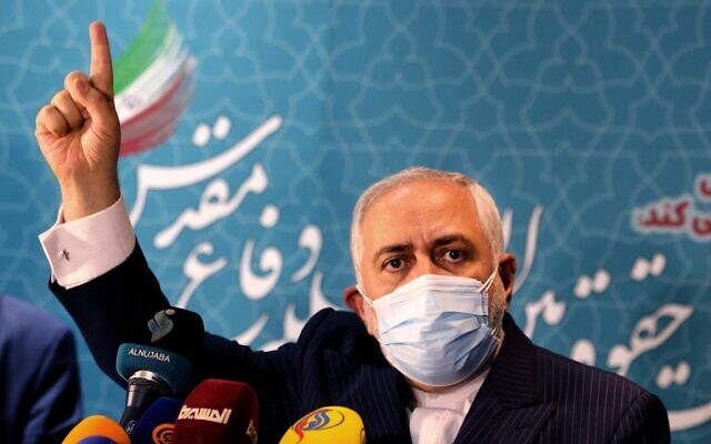 In this file photo taken on February 23, 2021, Iranian Foreign Minister Mohammad Javad Zarif addresses the media at the International Conference on the Legal-International Claims of the Holy Defense in the capital Tehran (ATTA KENARE / AFP)