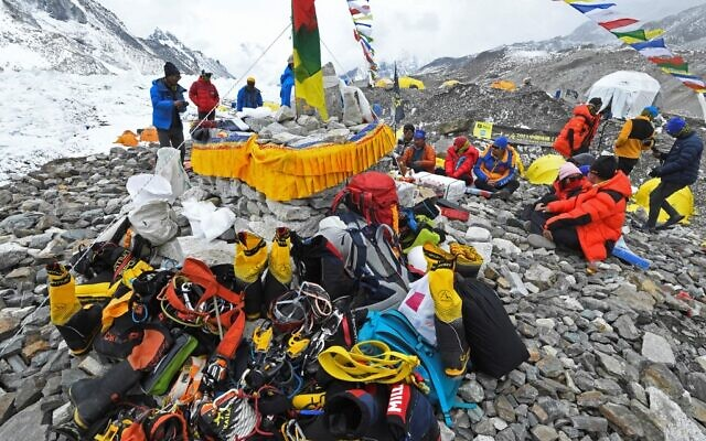 In this photograph taken on May 2, 2021, mountaineers, sherpas and team expedition members prepare for a ritual to pay their respects to Mount Everest before attempting to climb at Everest Base Camp in Solukhumbu district (Prakash MATHEMA / AFP)