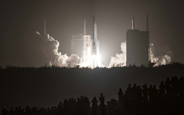 In this file photo a Long March 5B rocket carrying China's Chang'e-5 lunar probe launches from the Wenchang Space Center on China's southern Hainan Island on November 24, 2020, on a mission to bring back lunar rocks, the first attempt by any nation to retrieve samples from the moon in four decades (STR / AFP)