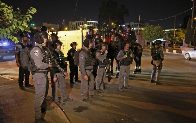 Israeli security forces deploy to disperse a protest by Palestinians against a possible eviction of local Palestinian families in the Sheikh Jarrah neighborhood of East Jerusalem, on May 8, 2021. (Menahem KAHANA / AFP)