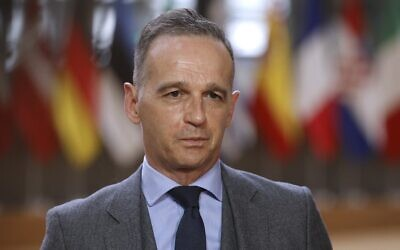 German Foreign Minister Heiko Maas speaks with the media upon his arrival for a meeting with EU foreign affairs ministers at the European Council building, in Brussels, on May 10, 2021. (Olivier Matthys/Pool/AFP)