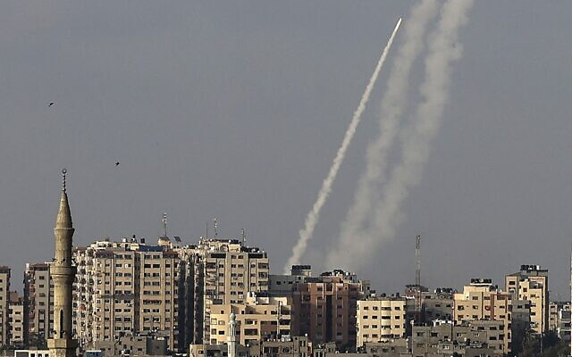 Palestinians terrorists fire rockets from Gaza City toward Israel on May 10, 2021. (Mahmud Hams/AFP)