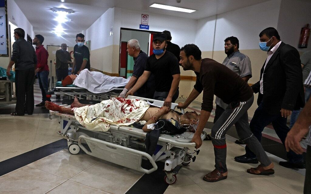 Palestinians transport an injured man amid a flare-up of Israeli-Palestinian violence, at a hospital in the northern Gaza Strip, on May 10, 2021. (MOHAMMED ABED / AFP)
