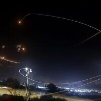 Israel's Iron Dome missile defense system intercepts rockets launched by Palestinians terrorists in the Gaza Strip, above the southern coastal city of Ashkelon, on May 10, 2021. (Jack Guez/AFP)