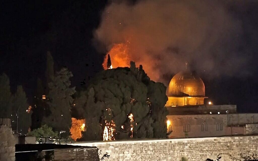 A grab from an AFPTV video shows a tree on fire near the Dome of the Rock on May 10, 2021. (Claire Gounon/AFPTV/AFP)