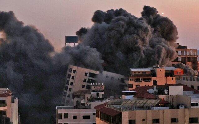 Smoke billows from an Israeli air strike on the Hanadi compound in Gaza City, controlled by the Palestinian Hamas terror group on May 11, 2021. (MOHAMMED ABED / AFP)