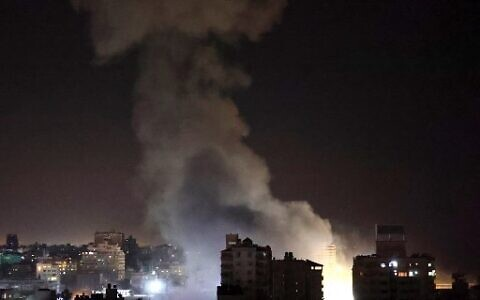 Smoke billows from Israeli air strikes in Gaza City on May 12, 2021. (Photo by MOHAMMED ABED / AFP)