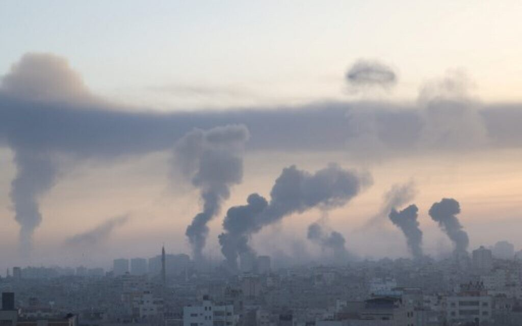 Smoke rises after a series of Israeli air strikes in Gaza City , early on May 12, 2021. (Photo by MOHAMMED ABED / AFP)