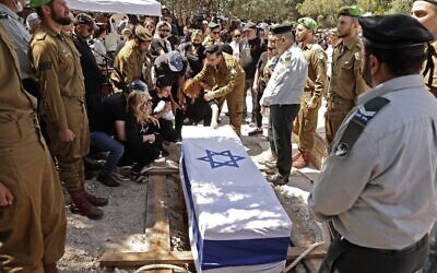 Mourners attend the funeral of Israeli soldier Omer Tabib, 21, in Elyakim in northern Israel, on May 13, 2021. Tabib was killed when Palestinian terrorists in Gaza fired an anti-tank missile near the border. (JACK GUEZ / AFP)