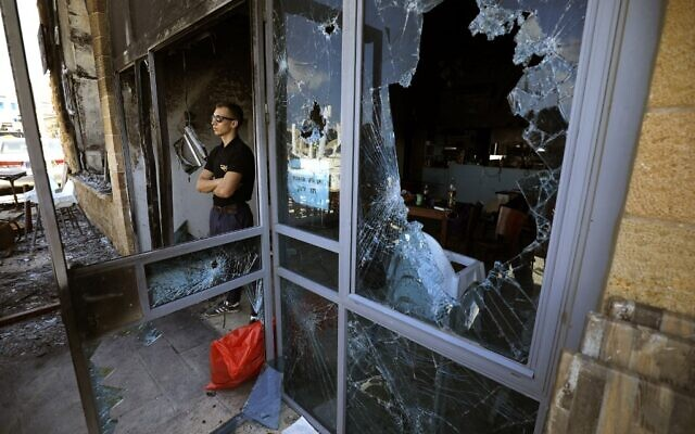 A May 13 photograph at Acre's Jewish-owned Uri Buri restaurant, known for its commitment to coexistence, after it was attacked and heavily damaged in riots in the city (JALAA MAREY / AFP)