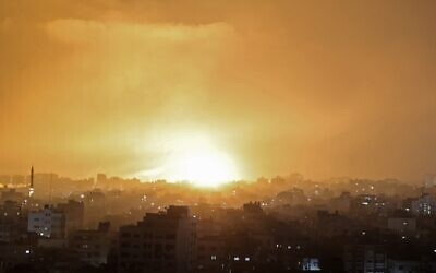 An explosion lights the sky following an Israeli air strike on Beit Lahia in the northern Gaza Strip on May 14, 2021. (Mohammed Abed/AFP)