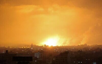 An explosion lights the sky following an Israeli air strike on Beit Lahia in the northern Gaza Strip early on May 14, 2021. (MOHAMMED ABED / AFP)