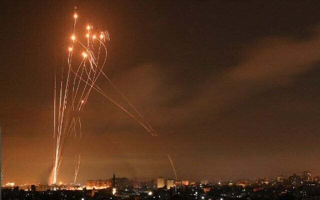 Hamas rockets and Iron Dome interceptors light up the night sky over the northern Gaza Strip on May 14, 2021.(Photo by MOHAMMED ABED / AFP)