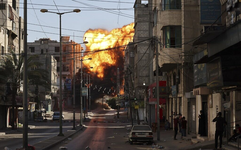Black smoke billows after an Israeli airstrike on Gaza City targeted the Intaj Bank linked to Hamas on May 14, 2021. (MOHAMMED ABED / AFP)
