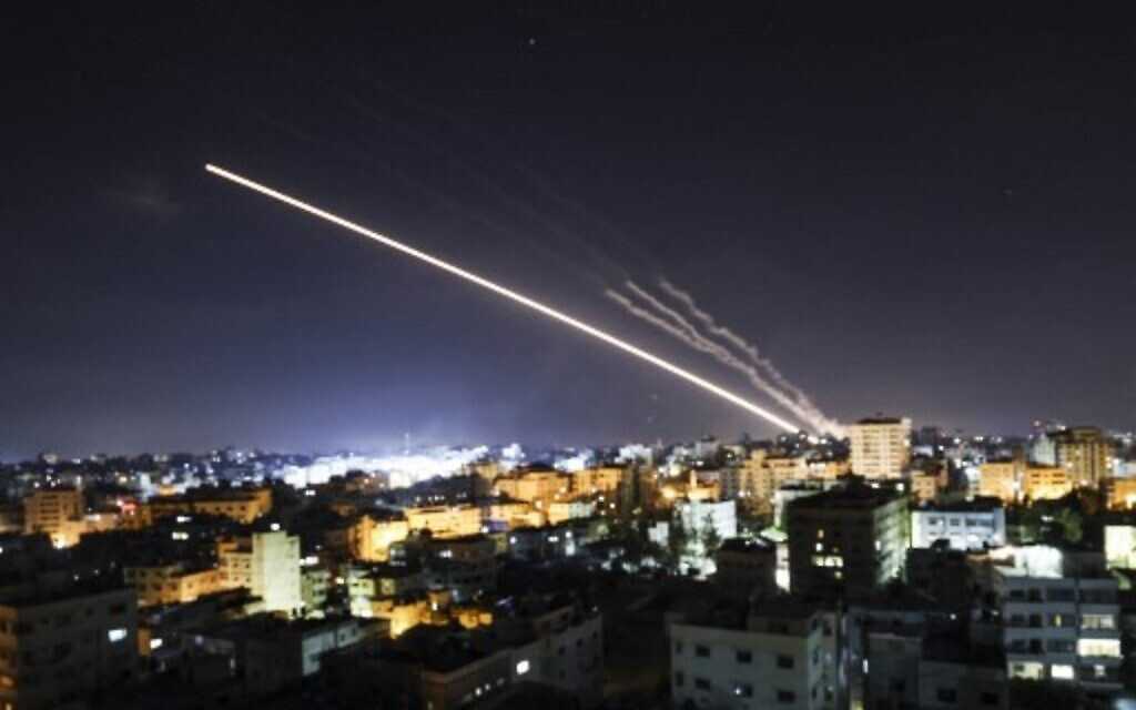 Rockets are launched from Gaza City,  towards Israel early on May 15, 2021. (Photo by MAHMUD HAMS / AFP)