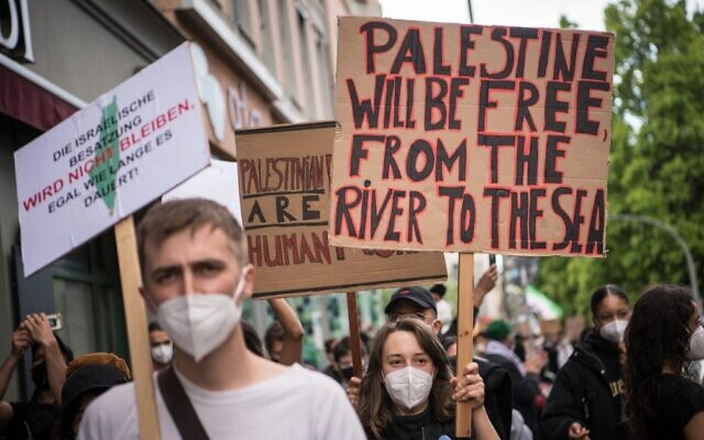 Pro-Palestinian protesters in Berlin take part in a demonstration against Israel amid the fighting in Gaza between the Israeli military and Hamas terror group, May 15, 2021. (Stefanie Loos/AFP)
