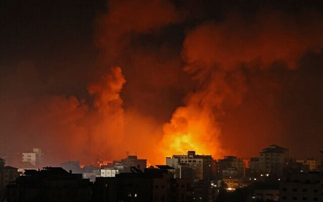 Smoke billows from a fire following Israeli airstrikes on multiple targets in Gaza City, early on May 16, 2021 (MOHAMMED ABED / AFP)