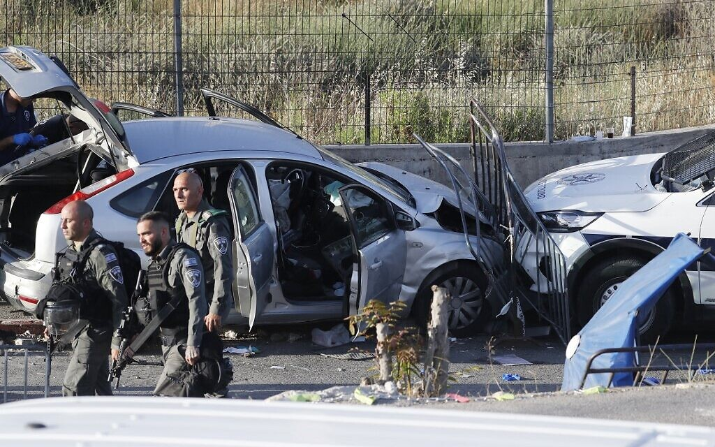 Israeli security forces inspect on May 16, 2021 the scene of a car-ramming attack in East Jerusalem. (Ahmad GHARABLI / AFP)