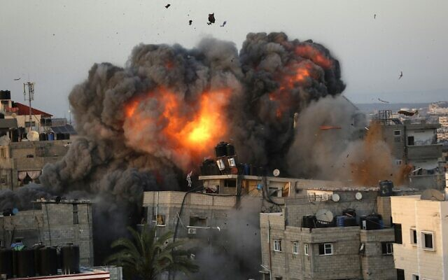 A ball of fire erupts from a building in Gaza City's al-Rima neighborhood on May 16, 2021, during a massive Israeli bombardment on the Hamas-controlled enclave. (Bashar Taleb/AFP)