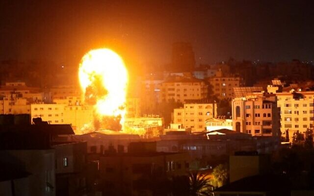 Fire and smoke rise above buildings in Gaza City as Israeli warplanes target the Palestinian enclave, early on May 17, 2021, amid the fighting between the Israel Defense Forces and Gaza-ruling Hamas terror group. (Anas Baba/ AFP)