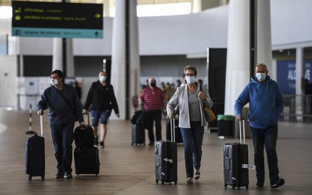 Illustrative: Passengers arrive at Faro airport in Algarve, south of Portugal, on May 17, 2021. (Patricia De Melo Moreira/AFP)