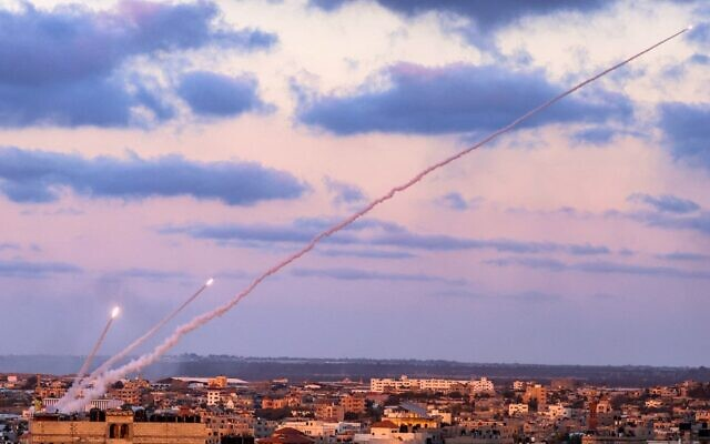 Rockets are launched by Palestinian terrorists in the southern Gaza Strip toward Israel, May 17, 2021. (Said Khatib/AFP)