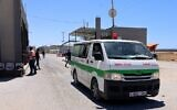 An ambulance passes into Rafah through the Kerem Shalom crossing, the main passage point for goods entering Gaza from Israel, in the southern Gaza Strip on May 18, 2021 (SAID KHATIB / AFP)
